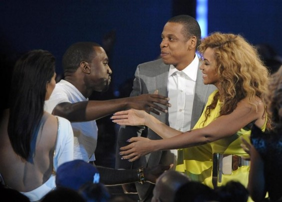 Singer Beyonce Knowles (R) congratulates Kanye West as rapper Jay-Z (rear) and actress Kim Kardashian (L) look on after West won the award for video director of the year at the 2012 BET Awards in Los Angeles, July 1, 2012.