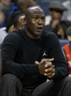 Charlotte Bobcats team owner Michael Jordan yells at a referee while watching his team play the Toronto Raptors during an NBA basketball game in Charlotte, North Carolina February 22, 2011.