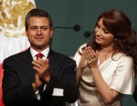 Enrique Pena Nieto (L), presidential candidate of the Institutional Revolutionary Party (PRI), claps next to his wife Angelica Rivera after exit polls showed him in first place, in Mexico City July 1, 2012.