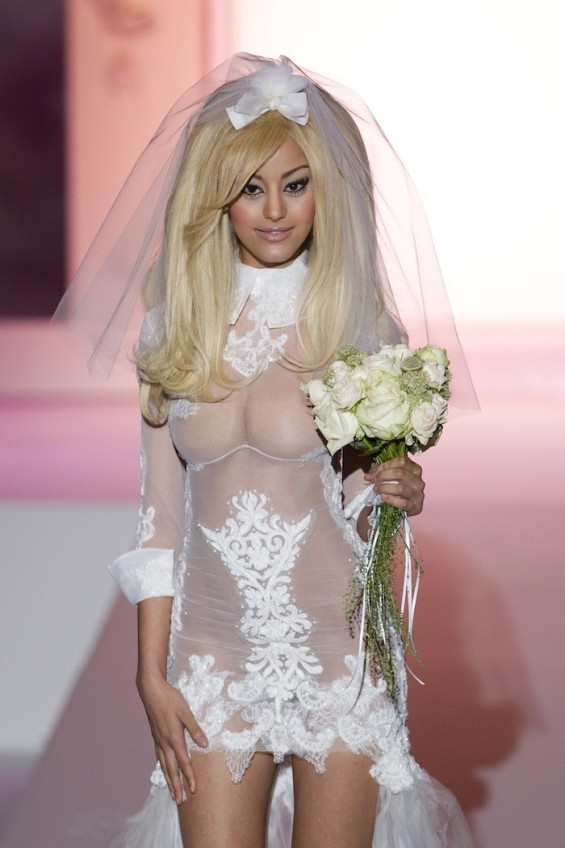 Zahia Dehar presents her Fall-Winter 2012/2013 high-fashion lingerie line during the Haute Couture fashion week in Paris July 2, 2012