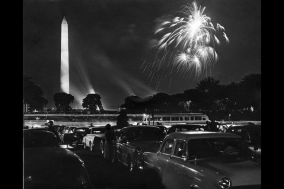 Crowds attend the fireworks on the National Mall with the Washington Monument in the background. Eisenhower administration, 7/4/1954. (White House)
