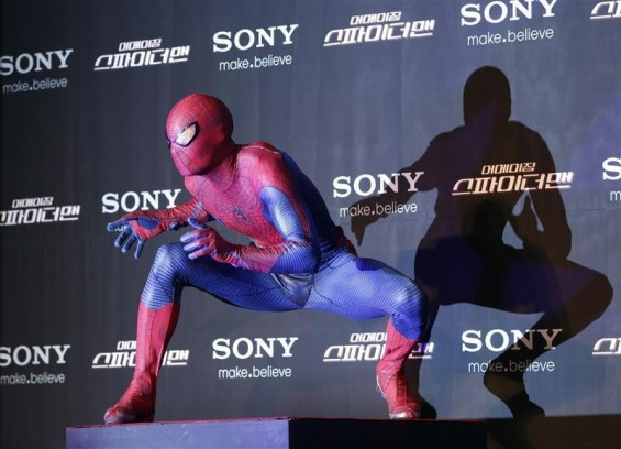 "A promoter wearing a Spider-Man costume performs before a news conference for the new movie ""The Amazing Spider-Man"" in Seoul June 14, 2012."