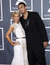 Paris Hilton and producer Afrojack arrive at the 54th annual Grammy Awards in Los Angeles, California February 12, 2012. REUTERS