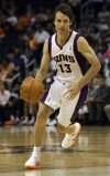 Phoenix Suns' Steve Nash dribbles up court during their NBA basketball game against the San Antonio Spurs in Phoenix, Arizona, April 25, 2012.