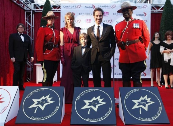 Actor Eric McCormack poses with his star on the red carpet with his wife Janet Leigh Holden and his son Finnigan during the 13th annual Canada's Walk of Fame in Toronto, October 16, 2010.
