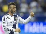 LA Galaxy's David Beckham gestures to the crowds following the end of their MLS soccer match against the Montreal Impact in Montreal, Quebec, May 12, 2012.