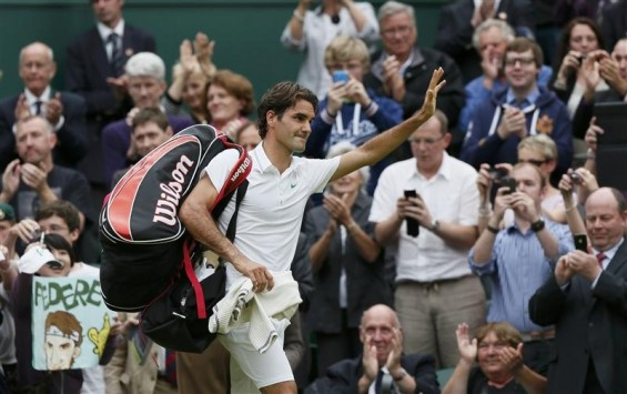 Roger Federer of Switzerland celebrates after defeating Novak Djokovic of Serbia in their men's semi-final tennis match at the Wimbledon tennis championships in London July 6, 2012.