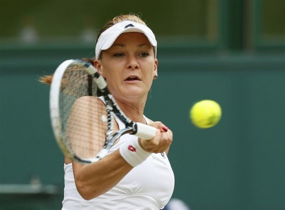 Agnieszka Radwanska of Poland hits a return to Serena Williams of the U.S. during their women's final tennis match at the Wimbledon tennis chamionships in London July 7, 2012.