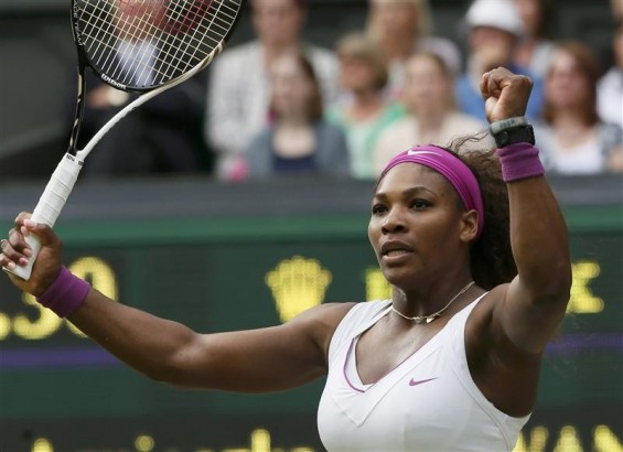 Serena Williams of the U.S. reacts to breaking the serve of Agnieszka Radwanska of Poland in the third set during their women's final tennis match at the Wimbledon tennis championships in London July 7, 2012. R