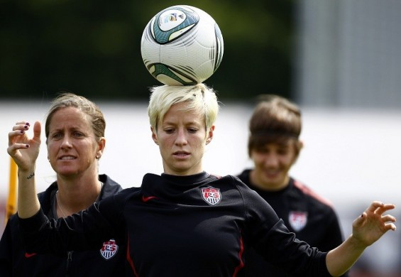 Megan Rapinoe of the U.S. balances a ball on her head during a practice session for the upcoming final of the women's soccer World Cup in Frankfurt July 15, 2011. The U.S. will play Japan in the World Cup final on Sunday in Frankfurt.