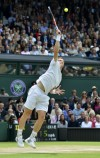 Andy Murray of Britain serves to Roger Federer of Switzerland in their men's singles final tennis match at the Wimbledon Tennis Championships in London July 8, 2012.