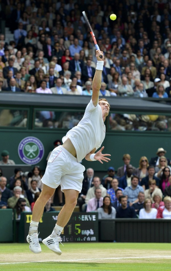Andy Murray of Britain serves to Roger Federer of Switzerland in their men