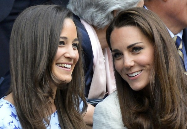 Britain's Catherine, Duchess of Cambridge (R) sits with her sister Pippa Middleton on Centre Court for the men's singles final tennis match between Roger Federer of Switzerland and Andy Murray of Britain at the Wimbledon Tennis Championships in