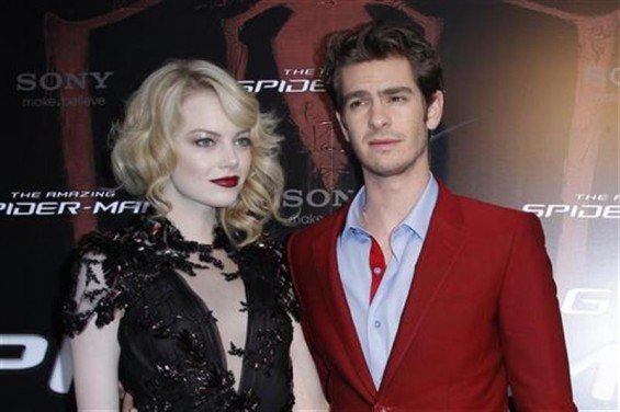 "Actor Andrew Garfield (R) and U.S. actress Emma Stone arrive for the French premiere of ""The Amazing Spider-Man"" in Paris June 19, 2012."