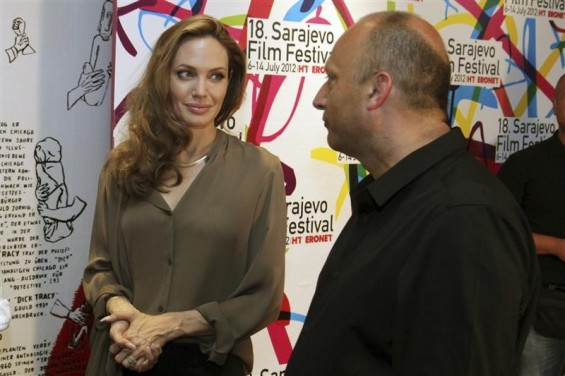 U.S. actress Angelina Jolie stands next to Mirsad Purivatra, director of the 18th Sarajevo Film Festival, before the festival July 7, 2012.