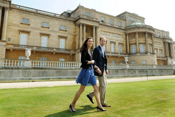 Prince William and Kate, Duchess of Cambridge, walk together in Buckingham Palace, following their wedding on Friday, in central London April 30, 2011. (Source:Reuters)