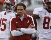Alabama head coach Nick Saban walks the sidelines during the first half of their NCAA college football game against Auburn in Auburn, Alabama November 26, 2011.