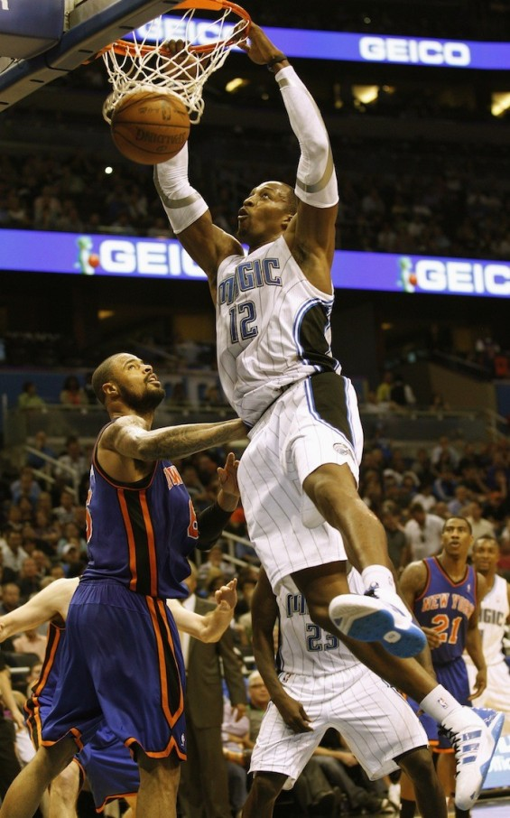 Orlando Magic&#039;s center Dwight Howard slams the ball over New York Knicks&#039; center Tyson Chandler during the second half of their NBA basketball game in Orlando