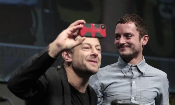 Cast member Elijah Wood (R) watches co-star Andy Serkis at the beginning of a panel for the film &#034;The Hobbit: An Unexpected Journey&#034; during the Comic Con International convention in San Diego, California July 14, 2012.
