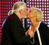 Former member of Swedish pop group 'ABBA' Anni-Frid Lyngstad (R) greets Jon Lord of 'Deep Purple' during the German media prize 'Die Goldene Henne' (The golden hen) award ceremony in Berlin September 22, 2004.
