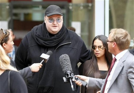 Megaupload founder Kim Dotcom talks to members of the media as he leaves the High Court in Auckland February 29, 2012.