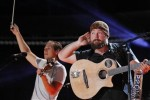 Zac Brown (R) and Jimmy De Martini of Zac Brown Band perform during the Country Music Association (CMA) Music Festival in Nashville, Tennessee June 7, 2012.