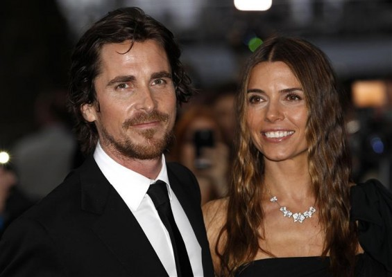 "British actor Christian Bale and his wife Sibi pose for photographers as they arrive at the European Premiere of ""The Dark Knight Rises"" in Leicester Square, central London, July 18, 2012."