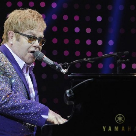 "British singer Elton John performs during a concert as part of his ""Greatest hits Live 2012"" world tour at the Ondrej Nepela Arena in Bratislava July 10, 2012."