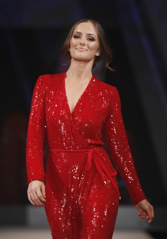 Model Minka Kelly presents a dress by designer Diane Von Furstenberg for the Heart Truth's Red Dress Fashion Show in New York