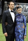 Director Rupert Sanders (L) and actress Liberty Ross pose for photographers as they arrive for the world premiere of &#034;Snow White and the Huntsman&#034; at Leicester Square in London May 14, 2012.