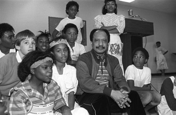 In this file photo provided by the Las Vegas News Bureau July 24, 2012, actor Sherman Hemsley visits sixth graders at Madison Elementary School in Las Vegas February 21, 1986.
