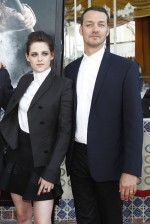 Director of the movie Rupert Sanders (R) poses with cast member Kristen Stewart