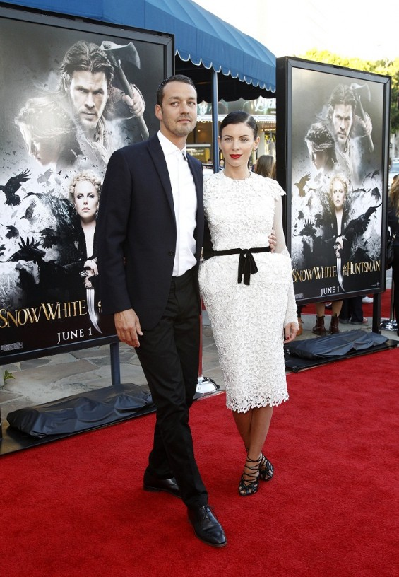 "Director of the movie Rupert Sanders poses with wife and cast member Liberty Ross at an industry screening of ""Snow White and the Huntsman"" at the Mann Village theatre in Westwood, California May 29,"