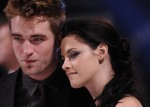 Actors Robert Pattinson (L) and Kristen Stewart arrive for the British premiere of 'The Twilight Saga: Breaking Dawn' at Westfield Stratford City cinemas in east London November 16, 2011.