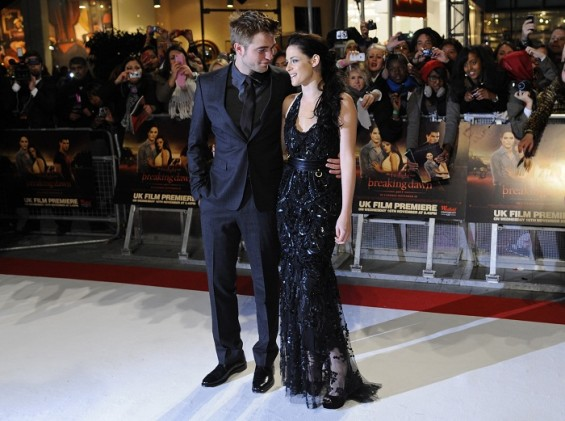 Actors Robert Pattinson (L) and Kristen Stewart arrive for the British premiere of &#039;The Twilight Saga: Breaking Dawn&#039; at Westfield Stratford City cinemas in east London November 16, 2011.  Full Shoot