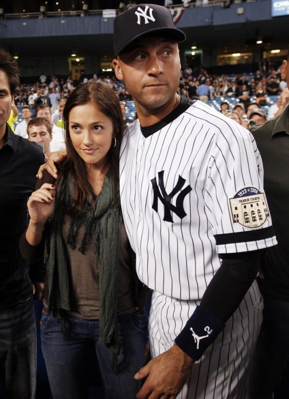 New York Yankees&#039; Derek Jeter hugs his former girlfriend actress Minka Kelly following the final regular season of MLB American League baseball game against the Baltimore Orioles at Yankee Stadium in 