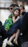 Suri Cruise carried by her father, actor Tom Cruise