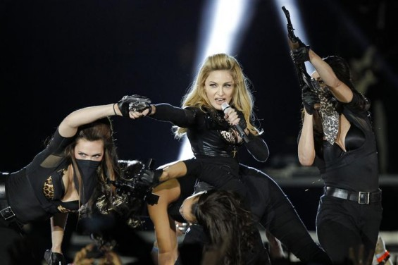 U.S. pop singer Madonna performs during a concert for her MDNA world tour at the Stade de France Stadium in Saint-Denis, near Paris, July 14, 2012.