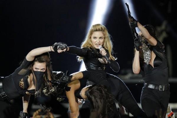 U.S. pop singer Madonna performs during a concert for her MDNA world tour at the Stade de France Stadium in Saint-Denis, near Paris, July 14, 2012.
