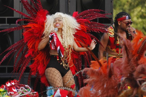 Trinidad-born hip hop artist Nicki Minaj (L), performs alongside soca artist Machel Montano during the filming of a carnival-themed music video for her song Pound the Alarm, in Belmont, July 4, 2012.