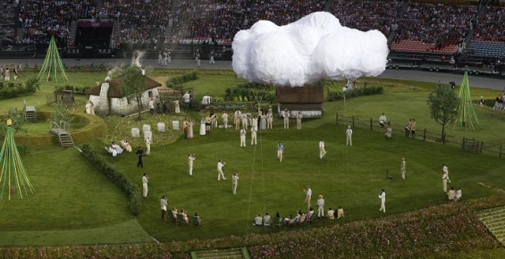 Performers are seen playing cricket on a village green before the opening ceremony of the London 2012 Olympic Games at the Olympic Stadium July 27, 2012.