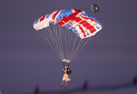 A parachutist dressed as Queen Elizabeth is seen during the opening ceremony of the London 2012 Olympic Games at the Olympic Stadium July 27, 2012.