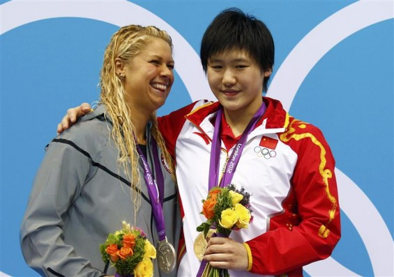 China&#039;s Ye Shiwen (R), with her gold medal, smiles with silver medal winner Elizabeth Beisel of the U.S. during the women&#039;s 400m individual medley victory ceremony at the London 2012 Olympic Games at 