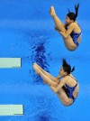 Team China's Wu Minxia and He Zi take home the Gold medal in the 2012 Olympics for women's 3-meter synchronized diving