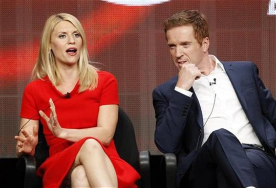 "Cast member Claire Danes speaks, as co-star Damian Lewis watches, at a panel for ""Homeland"" during the Showtime television portion of the Television Critics Association Summer press tour in Beverly Hi"