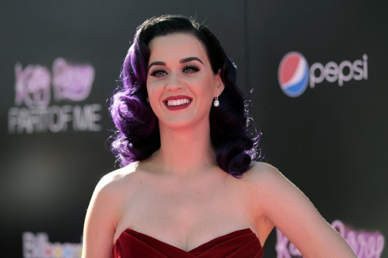"Katy Perry poses at the premiere of her film ""Part of Me."" The singer is nominated in four categories at the MTV VMAs 2012 but things have not gone as well in her personal life. Last year, she attende"