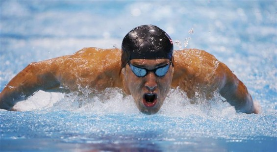 Michael Phelps of the U.S. swims to a first place finish in his men's 200m butterfly semi-final at the London 2012 Olympic Games at the Aquatics Centre July 30, 2012.