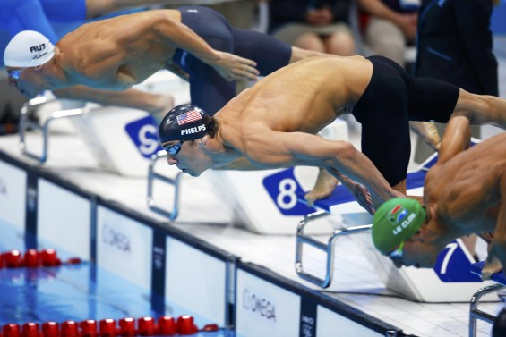 Michael Phelps (C) of the U.S. competes with Austria's Dinko Jukic (L) and Chad le Clos of South Africa in the men's 200m butterfly final during the London 2012 Olympic Games at the Aquatics Centre Ju
