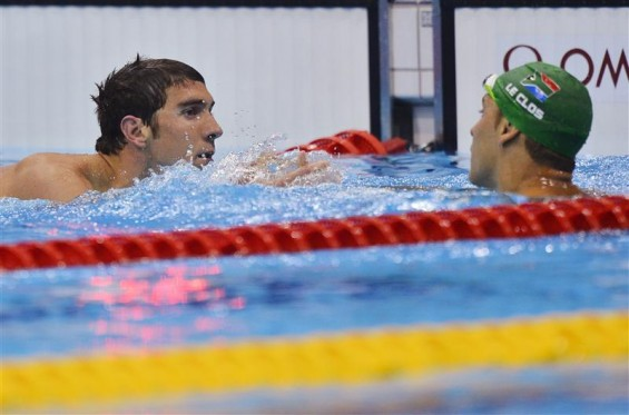 Michael Phelps (L) of the U.S. congratulates South Africa's Chad le Clos after the latter won the men's 200m butterfly final during the London 2012 Olympic Games at the Aquatics Centre July 31, 2012.