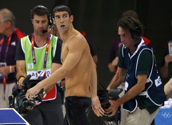 Michael Phelps of the U.S. leaves the pool deck after winning the silver medal in the men's 200m butterfly final during the London 2012 Olympic Games at the Aquatics Centre July 31, 2012. Phelps, who
